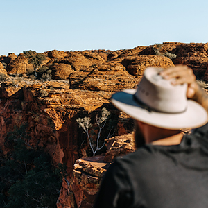 Website Gallery 0001 131364 56 Man looking across Kings Canyon Mandatory credit Tourism NT and Jess Caldwell and Luke